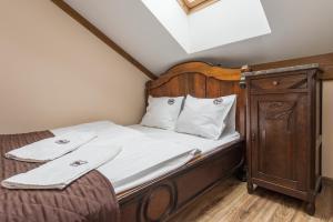 Łóżko lub łóżka w pokoju w obiekcie Pokoje Gościnne Ranczo Baranówka