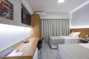 Cama ou camas em um quarto em Le Canard Joinville