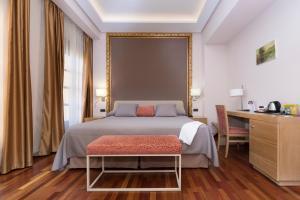 Säng eller sängar i ett rum på Casa Consistorial