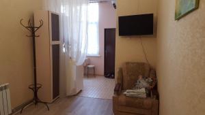 Телевизор и/или развлекательный центр в Apartment Первомайский 7