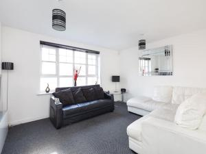 A seating area at My-Places Abbotsfield Court Townhouse 3