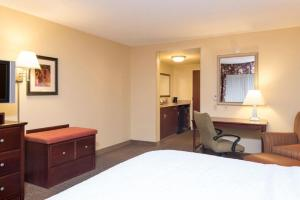 A bed or beds in a room at Hampton Inn Schenectady