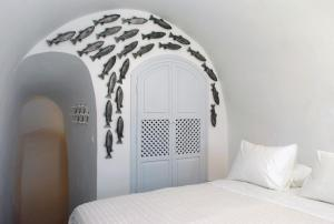 A bed or beds in a room at Ikies Santorini