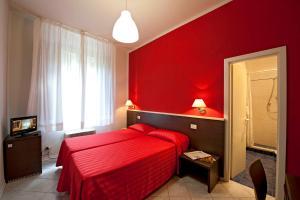 Letto o letti in una camera di Hotel Moderno