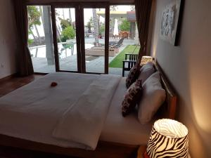 A bed or beds in a room at Pebble & Fins Bali Resort