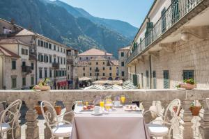 A restaurant or other place to eat at Historic Boutique Hotel Cattaro