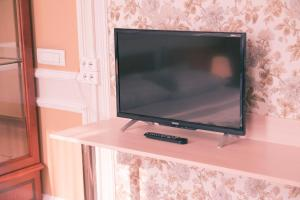 A television and/or entertainment center at Aroom Hotel on Kitai Gorod
