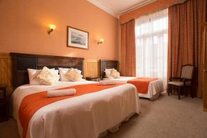 Cama o camas de una habitación en Hotel Plaza