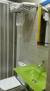 Un baño de Apartamentos Santana