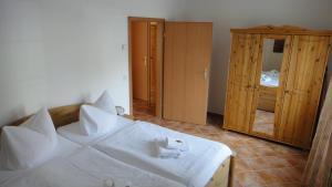 Ein Bett oder Betten in einem Zimmer der Unterkunft Kumm Wedder