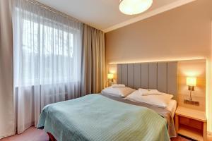 Łóżko lub łóżka w pokoju w obiekcie UNO II Apartment