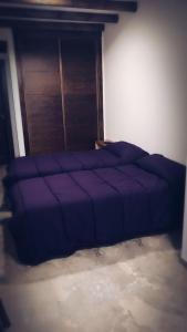 Cama o camas de una habitación en Posada de Momo