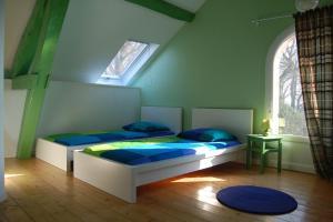 Un ou plusieurs lits dans un hébergement de l'établissement Hebergements Insolites - Etretat Aventure