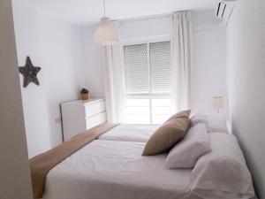 Cama o camas de una habitación en Apartamento Malagueta