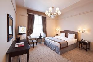 Ein Bett oder Betten in einem Zimmer der Unterkunft Hotel Metropole