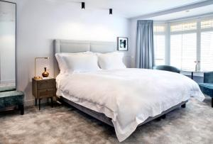 A bed or beds in a room at Pillows Luxury Boutique Hotel Anna Van Den Vondel Amsterdam