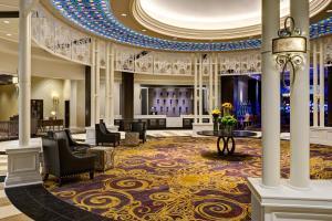 The lobby or reception area at Saratoga Casino Hotel