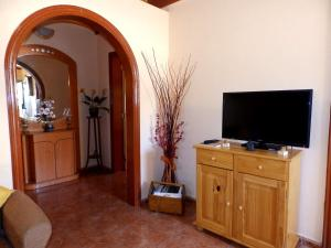 A television and/or entertainment center at Casa Rural Isabel