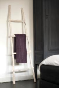 A bed or beds in a room at B&B Buitenplaats Natuurlijk Goed