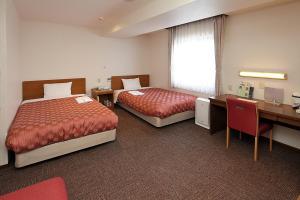 久米川ウィングホテルにあるベッド
