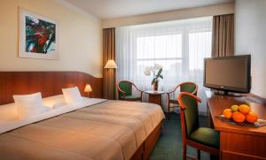 A bed or beds in a room at Clarion Congress Hotel Ostrava