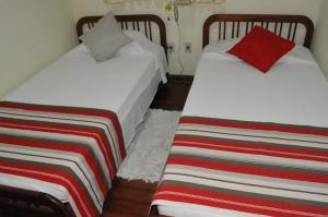 A bed or beds in a room at Hotel da Reserva Natural Vale