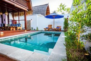 The swimming pool at or near Gili Air Sanctuary Villa and Resort
