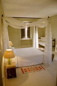 A bed or beds in a room at Azienda Agricola Mandranova