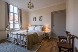A bed or beds in a room at Braamberg B&B