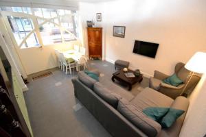 Ein Sitzbereich in der Unterkunft Holiday Home Het Koetshuis