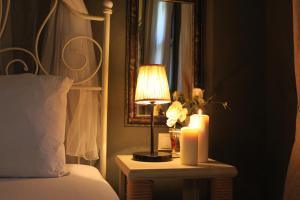 Кровать или кровати в номере Han Boutique Hotel