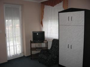 A television and/or entertainment centre at Mika Vendégház