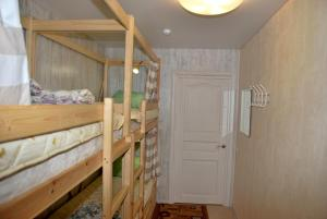 A bunk bed or bunk beds in a room at Hostel Gurtyeva