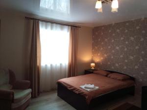 Кровать или кровати в номере Apartment kak doma