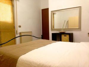 Letto o letti in una camera di Rejoice Apartment