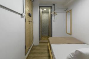A bed or beds in a room at ORA Hostel Bangkok
