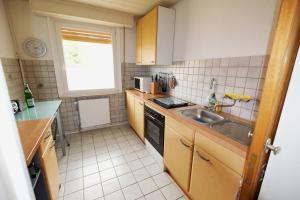 Küche/Küchenzeile in der Unterkunft Wolfsbau Ferienwohnung