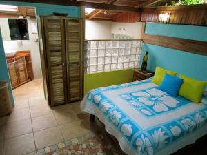 A bed or beds in a room at Physis Caribbean Bed & Breakfast