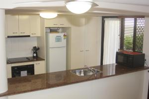 "A kitchen or kitchenette at ""The Apartments"" Kings Beach Surfside"