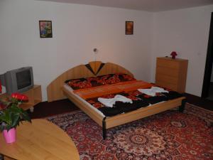 Postel nebo postele na pokoji v ubytování Pension Lípa