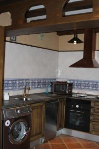A kitchen or kitchenette at Apartamentos Rurales Esencias De La Alcarria