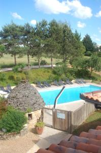 The swimming pool at or near Hotel Le Mas de Castel