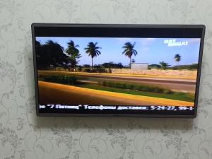 A television and/or entertainment center at Apartments Мира 2 Б