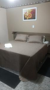 A bed or beds in a room at Hotel Dom Daniel