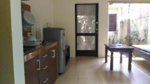 A kitchen or kitchenette at Praschita Bali