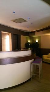 The lobby or reception area at Ambassador Suites Antwerp