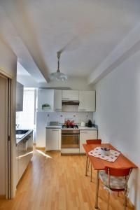 A kitchen or kitchenette at Affittacamere Anna Michielini