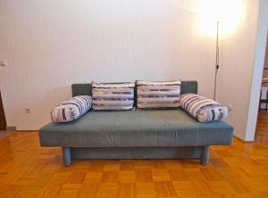 A seating area at Apartments Dubravka 1315