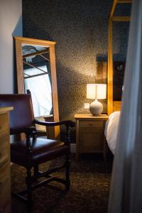 A bed or beds in a room at The Blue Boar
