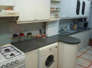 A cozinha ou cozinha compacta de Apartament on Mirzaaga Aliyev 138